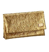 I Need This: Louis Vuitton Limelight Clutch in Gold