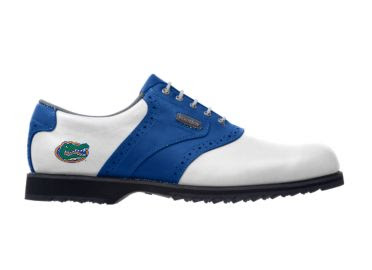 UF golf shoes for ladies that are white with a blue stripe and a gator logo near the arch support area.