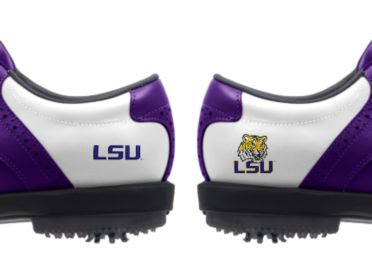 LSU golf shoes with purple trim on white base with two different logos of Tiger mascot and writing of LSU in purple above black rubber cleats.