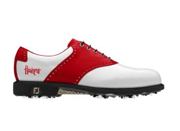 Red and white Nebraska golf shoe in classic design with the Huskers logo written across the back of this FJ piece of golf footwear that has black shoelaces and a rubber sole.