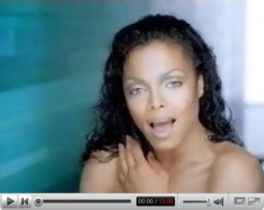 Janet Jackson caught sunbathing nude.