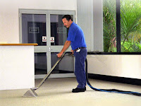 worker steam cleaning carpet dutch touch carpetcleaning services