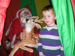 santa in tent with cuddly reindeer