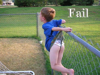 boy caught on fence wedgie