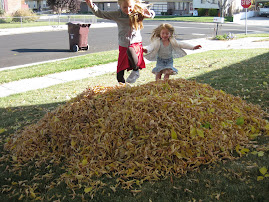 Ashlee & Lydia jumping in leaves