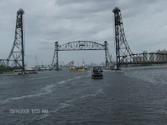 Jordan Lift Bridge has been removed from Norfolk Harbor.   See the tug pushing a barge toward us.