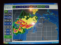 YA's weather map. Red is thunderstormL  We are located at the reflection of the flash