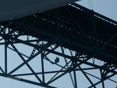 He's waving at me while painting the Mackinaw Island Bridge.  YIKES!