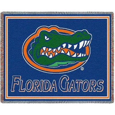 Green Gator head University of Florida blanket with blue background.