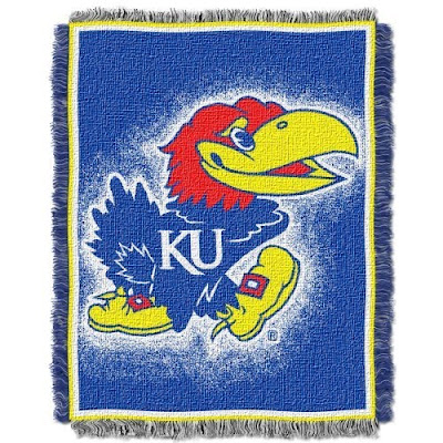 University of Kansas blanket that is blue with a KU Jawhawks mascot logo.