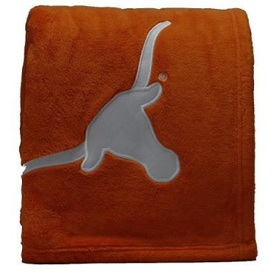 Burnt orange and white hook em horns fleece blanket with white longhorns logo.