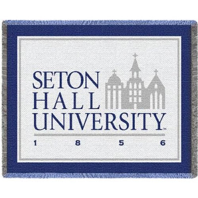 Seton Hall University Pirates blue and white throw blanket.
