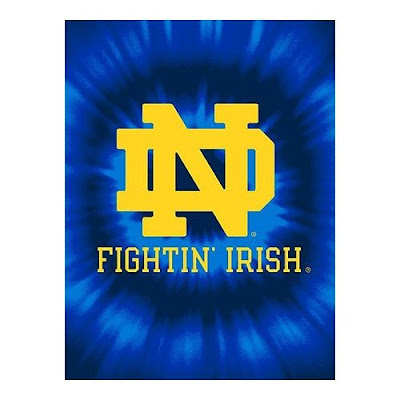 ND Fighting Irish tie die blanket that is blue and gold.