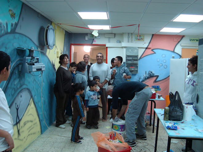 Happy parents in a shelter in Sderot