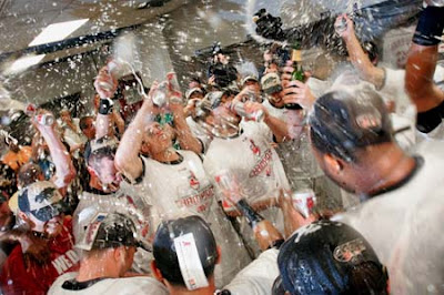 Cleveland Indians celebrate in the clubhouse after they defeated the Oakland Athletics to clinch the AL Central Division at Jacobs Field on Sunday, Sept. 23, 2007, in Cleveland, Ohio. (Lew Stamp/Akron Beacon Journal)
