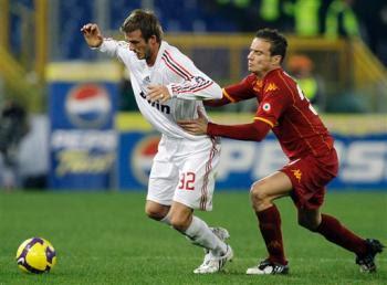David Beckham against Matteo Brighi