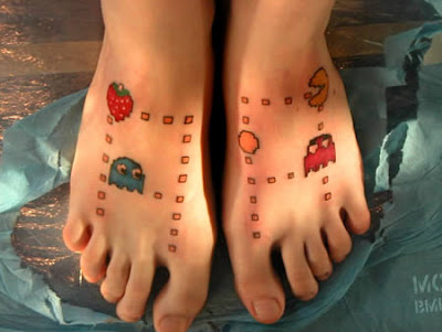cute tattoos on your foot. A foot tattoo of Pac-Man and