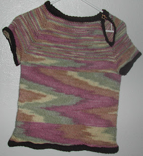 This short sleeve sweater is still for sale, a great way to keep warm when you don't want long sleeves.