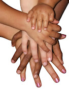 Children's Hands stacked on top of each other