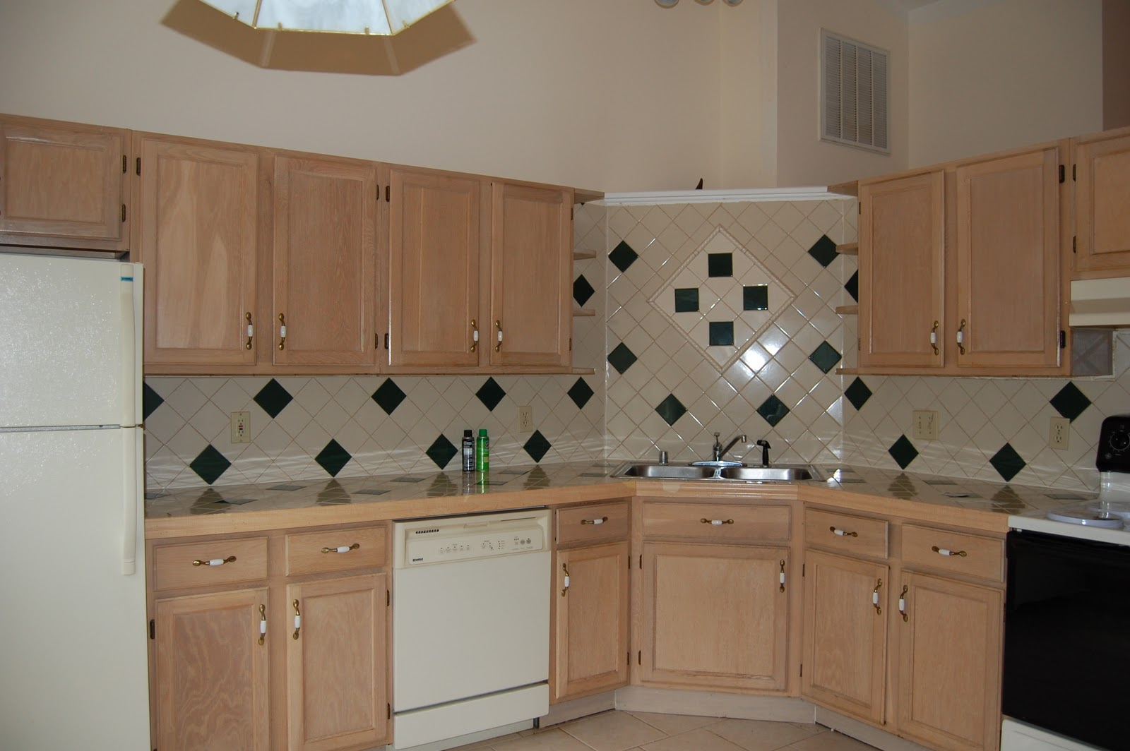 how to refinish painted kitchen cabinets