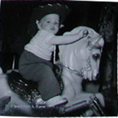 child on toy horse