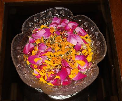 Flower petals in water container