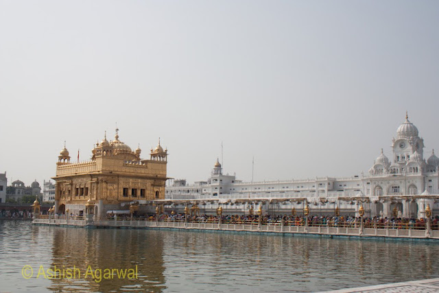 Side view of the causeway along with the Darbar Sahib in the middle of the holy sarovar in Amritsar