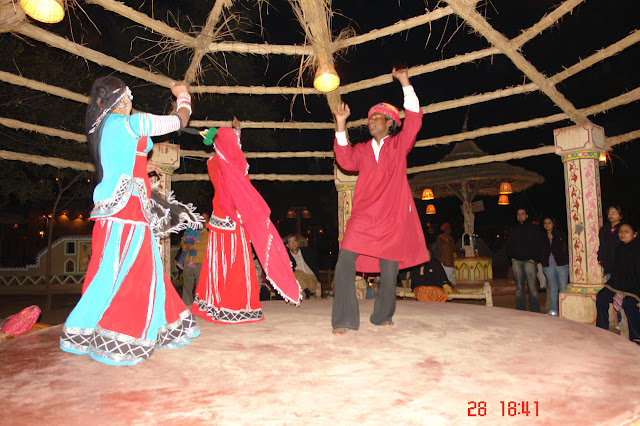 Photo of Dancers in traditional attire at the cultural village of Chokhi Daani