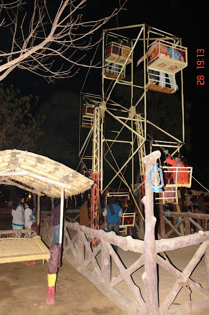 Photo of a manually operated Ferris wheel inside the tourist village of Chokhi Dhani