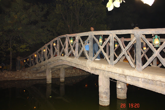 Photo of Small bridge over a stream inside the tourist village of Chokhi Dhani