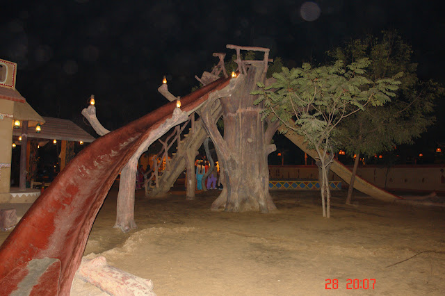 Photo of A slide made to seem as made out of a tree inside Chokhi Dhani