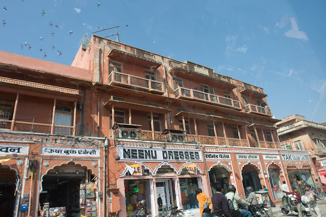 A view of the shops in the Jaipur old market, taken from inside a car