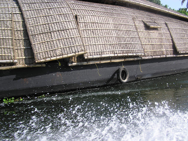 The side of a houseboat on the waterways in Alleppey in Kerala, India