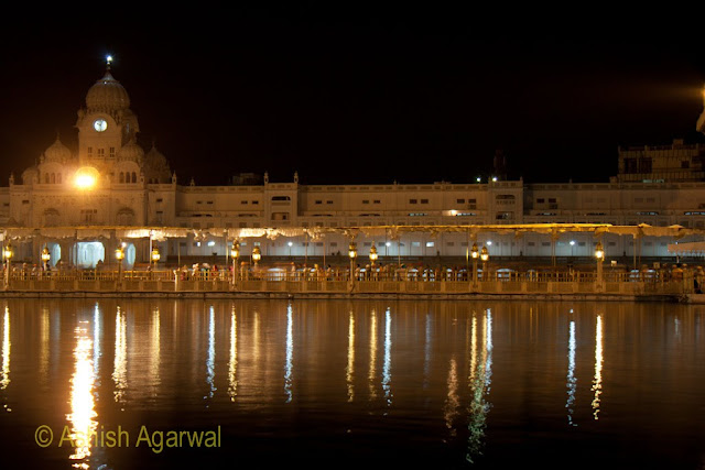 View of the devotees in the causeay leading to the Harmandir Sahib in the Golden Temple