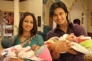 Shree and Hari on the Zee TV show with their apparent newborns