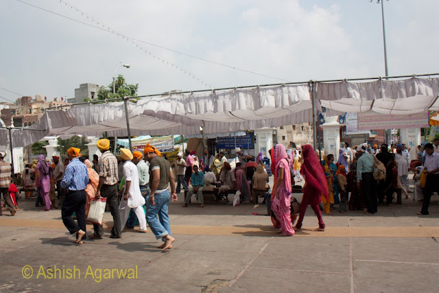 Devotees walking inside the complex, but outside the inner entrance to the Golden Temple