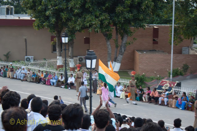 Girls running with the Indian flag at the Wagah border between India and Pakistan
