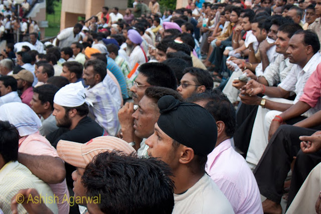 Close up of people in the crowd coming to watch the flag lowering ceremony at the Wagah Border