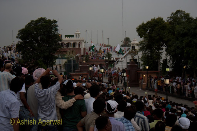 Flags halfway down the flagstaff at the Beating the Retreat ceremony at Wagah Border near Amritsar