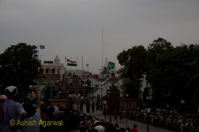 Both the Pakistani and Indian flags fluttering in the wind at the Wagah Border near Amritsar