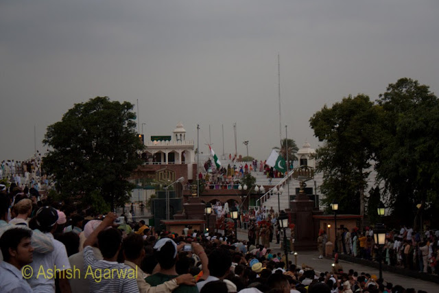 The Indian and Pakistani flags more than half way down their flag-staffs at the Wagah Border