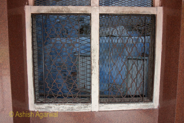 Window in the martyrs well inside Jallianwala Bagh in Amritsar