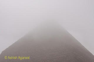Cairo Pyramids - The top of the Great Pyramid covered by fog