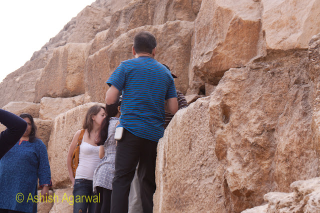 Cairo Pyramids - People jostling at the entrance to the Great Pyramid in Giza