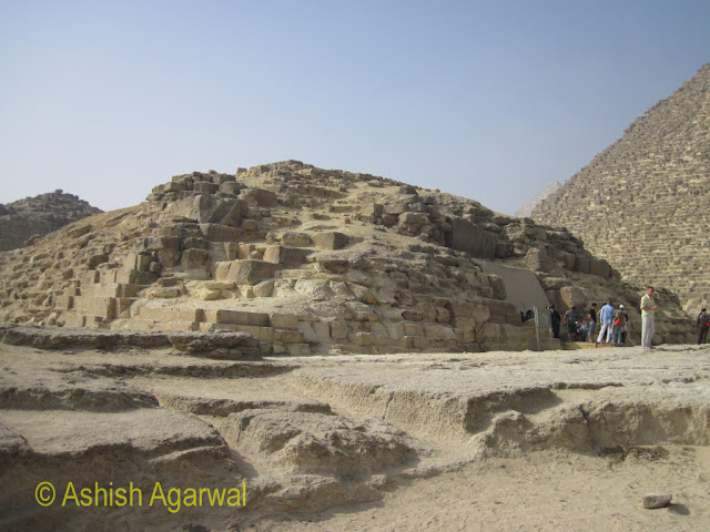 Cairo Pyramids - An outer view of the structure right next to the Great Pyramid that contains a burial chamber where people can go