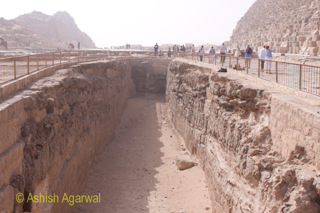 Cairo Pyramid - Deep pit right next to the Great Pyramid of Giza - maybe for excavation, or the site of solar boats