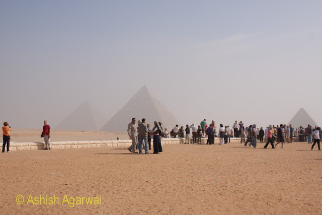 Cairo Pyramids - People standing at the Panorama point in Giza from where you can see all 3 Great Pyramids, Stock Photo