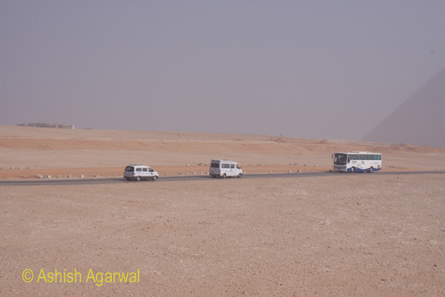 Panorama point in Giza - tourist buses to and from on the road between the Panorama point and the pyramid