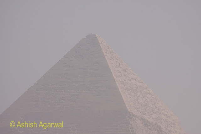 Great Pyramids - view of the majestic Great Pyramid, with the view a bit hazy because of sand