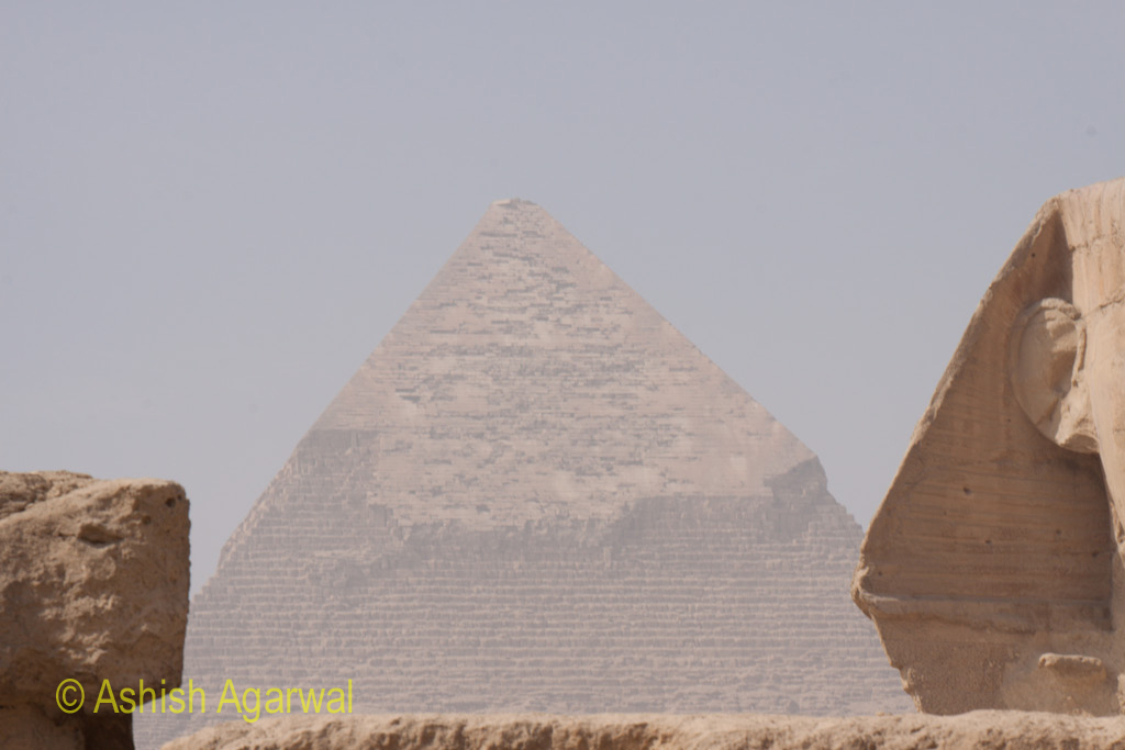 View of the Great Pyramid, with a small section of The Great Sphinx being visible